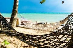 在海滩的吊床在多暴风雨的天气 免版税库存图片