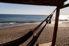 在海滩的吊床 免版税库存图片