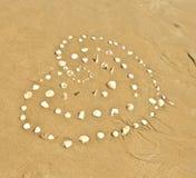 在海滩的图象心脏 图库摄影