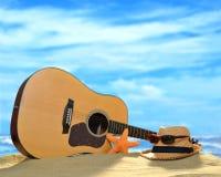 在海滩的声学吉他 免版税库存照片