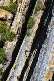 在海滨的复理层岩石在水中 免版税库存照片
