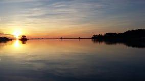 在海洋的安静的日出 图库摄影