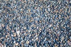 在海滩的小的石头 免版税库存图片