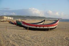 在海滩的小船在Nazare,葡萄牙 免版税库存照片