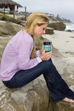 在海滩的少妇清早 图库摄影