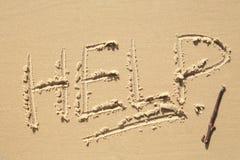 在海滩的帮助标志 库存照片