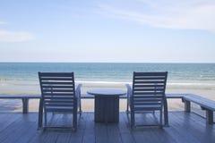 在海滩的摇椅 图库摄影