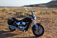 在海滩的摩托车 免版税库存照片