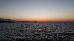 在海洋的日出 免版税库存照片