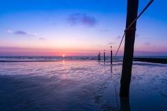 在海滩的日落诺尔德尔奈 免版税库存照片