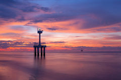 在海滩的日落以后 库存照片