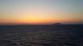在海洋的日落 库存图片
