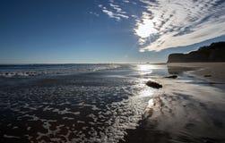 在海滩1的日落 免版税库存图片