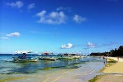 在海滩的早晨太阳 免版税库存照片