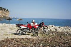 在海滩的本田摩托车 库存图片