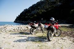 在海滩的本田摩托车 库存照片