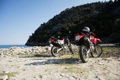 在海滩的本田摩托车 图库摄影