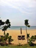 在海滩的椅子在夏天 库存照片