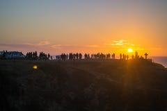 在海滩的橙色日落 库存照片