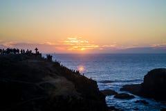 在海滩的橙色日落 免版税图库摄影