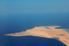 在海洋的沙漠地球 库存图片