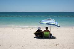 在海滩的浪漫天 免版税库存图片