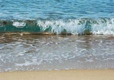 在海滩的海浪 库存照片