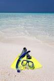 在海滩的潜航的齿轮 免版税库存照片