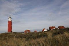 在海滩的灯塔 免版税库存照片