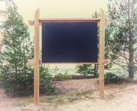 在海滩的空白的广告牌 免版税库存照片