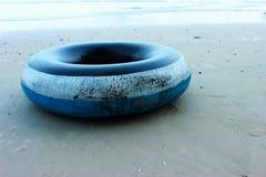 在海滩的管游泳 免版税库存图片