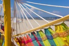 在海滩的色的吊床 库存图片