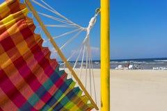 在海滩的色的吊床 免版税图库摄影