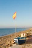 在海滩的西班牙旗子 免版税图库摄影