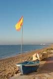 在海滩的西班牙旗子 图库摄影