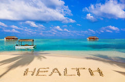 在海滩的词健康 库存图片