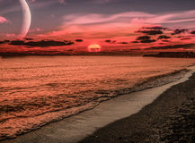 在海滩的超现实的日落 图库摄影