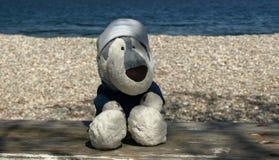 在海滩的长毛绒爱斯基摩 免版税库存图片
