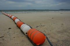 在海滩的障碍 免版税库存照片
