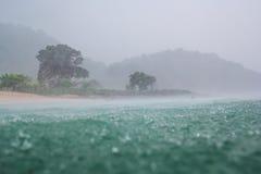 在海洋的雨在松巴哇岛 免版税库存图片
