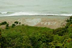 在海滩的题字我爱你 图库摄影