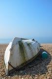 在海滩的颠倒的划艇 免版税图库摄影