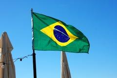 在海滩的巴西旗子 库存照片
