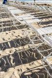 在海滩的Sunloungers 免版税库存图片