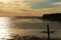在海滩风景的日落 库存图片