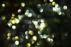 在淡色五颜六色的颜色,背景, bokeh的金黄银色黑暗的圆光 库存图片
