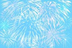 在淡色深蓝颜色背景的烟花庆祝 免版税图库摄影