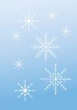 在淡蓝的背景的雪花 图库摄影