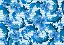 在淡蓝的镶边背景的精美蓝色花 库存图片