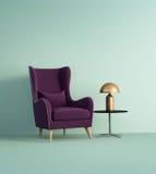在淡绿色的墙壁的紫罗兰色扶手椅子 免版税库存图片